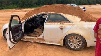 7979b4b5-cadillac-covered-in-dirt-352x198.jpg