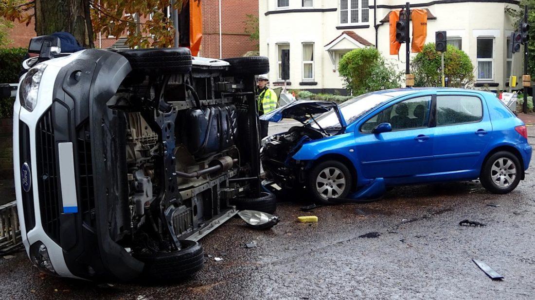 blue-car-and-white-van-crash-1100x618.jpg