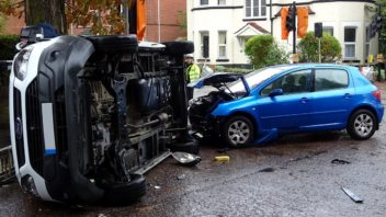 blue-car-and-white-van-crash-352x198.jpg
